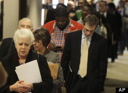 In this Nov. 10, 2011 photo, jobseekers line up for a career fair in Independence, Ohio (AP Photo/Tony Dejak)