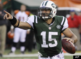 New York Jets quarterback Tim Tebow looks downfield in the first half of an NFL preseason football game against the Cincinnati Bengals, Friday, Aug. 10, 2012, in Cincinnati.