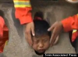 A Chinese boy had to be rescued after getting his head stuck in a stone guardrail.