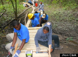 File Photo. A crew of Detroit teens construct a 24 foot wooden bridge over a Rouge River drainage canal. (Jhon Clark)