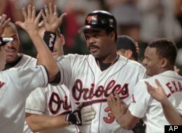 Baltimore Orioles Eddie Murray, center, is mobbed by teammates as he returns to home plate after hitting his 500th career home run against the Detroit Tigers Friday, Sept. 6, 1996 at Camden Yards. At far right is Orioles Rafael Palmeiro and beside him is Manny Alexander.