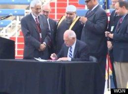 Gov. Pat Quinn signs a religious tolerance bill into law. (WGN)