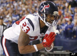 Houston Texans' Arian Foster reacts following a 9-yard touchdown run during the first half of an NFL football game against the Indianapolis Colts on Thursday, Dec. 22, 2011, in Indianapolis. (AP Photo/Michael Conroy)