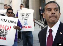 Los Angeles Mayor Antonio Villaraigosa, talks to the media at a news conference during a demonstration in Los Angeles. The group was reacting to a Supreme Court decision to overturn three parts of the Arizona immigration law but uphold a section that requires police to check the status of people who might be in the U.S. illegally. (AP Photo/Nick Ut)