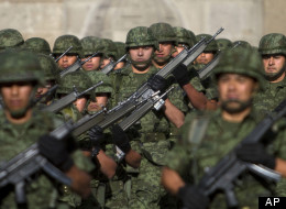 CAPTION: Soldiers march during a flag lowering ceremony in downtown Mexico City Monday, April 23, 2012. (AP Photo/Dieu Nalio Chery)