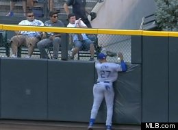 Matt Kemp crashes into the wall during the Dodgers-Rockies game on August 28, 2012.