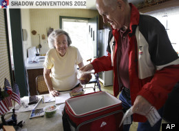 Marty Robertson unpacks food from the Chagrin Falls Meals on Wheels program for recipient Bernadette Winko, 90, in her Bentleyville, Ohio home. A study found food insecurity among seniors has risen sharply since 2001.