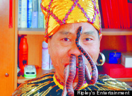 For 30 years, Liu Fei of China has been pulling snakes through his nose, sometimes two at once.