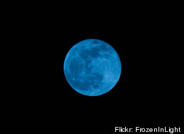 The second full moon of the month, 'Blue moon' is seen in the sky on 31 December 2009. According to the modern definition of the expression, when the full moon appears twice in a month, the second one is called blue moon. Flickr: FrozenInLight
