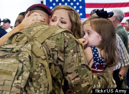 Caroline Scott welcomes home her husband, Army Sgt. Jerry Scott of the 82nd Airborne's 1st Brigade Combat team, Aug. 20. He served six months in Afghainstan. Photo by Sgt. Mike MacLeod, Flickr/U.S. Army