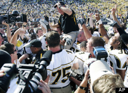 Appalachian State coach Jerry Moore is carried off the field at Michigan Stadium by his players after they upset No. 5 Michigan 34-32 in a football game Saturday, Sept. 1, 2007 in Ann Arbor, Mich. (AP Photo/Duane Burleson)