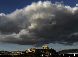 The ancient temple of Parthenon atop the Acropolis hill is illuminated by late evening sunlight in Athens on May 18, 2010. (ARIS MESSINIS/AFP/Getty Images)