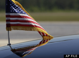 An American Flag is seen on the hood of President Barack Obama's motorcade vehicle, Friday, April 27, 2012, at Hunter Army Airfield, Ga. (AP Photo/Carolyn Kaster)