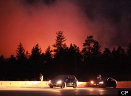 Wildfire burns out of control along highway 97C near Peachland, B.C. on Sunday Sept. 9, 2012. (Jeff Bassett, CP)
