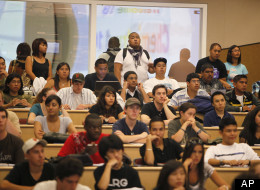 Students stand in the back row of a filled chemistry class at the California State University East Bay in Hayward, Calif., Wednesday, Sept. 23, 2009. Over 50 students were on a waiting list for the class. It isn't just tuition hikes driving up the cost of college. In cash-strapped California and around the country, deep budget cuts are trapping more college students in a kind of enrollment purgatory, where they're in school but can't get seats in the courses they need to move toward a degree. Th