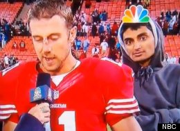 A man videobombs Alex Smith and Michael Crabtree of the San Francisco 49ers during a post-game interview.