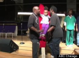 Bishop Larry Trotter's granddaughter being mock-crucified in a protest to the teacher strike. (ABC Chicago)