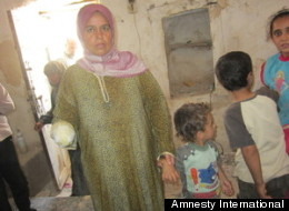 Maryam al-Sadd lost her right hand; her daughter, Rama Maklluta, was killed; and her son, Naji, 2, lost a finger when a 120mm mortar struck their home in Kfar Ruma, Syria, on July 25. (Amnesty International)
