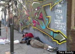 Two young men sleep on a sidewalk near Polk Street in San Francisco's Tenderloin neighborhood Sept. 14, 2012. Social service workers worry that some homeless youth are trading sex to survive but have had difficulty finding and assisting them.