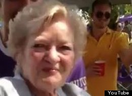 An 83-year-old woman does a keg stand during an LSU tailgate party.