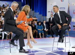 President Barack Obama participates in a town hall hosted by Univision and Univision news anchors Jorge Ramos, left, and Maria Elena Salinas, center, at the University of Miami, Thursday in Coral Gables, Fla. (AP Photo/Carolyn Kaster)