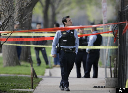 Police officers work a crime scene where they discovered the bodies of three shooting victims at a home on Chicago's Southwest side Wednesday, April 30, 2008 in Chicago. (AP Photo/M. Spencer Green)