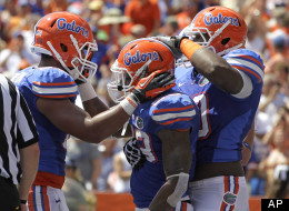 Florida running back Mike Gillislee, center, celebrates a 1-yard touchdown against Kentucky with tight end Clay Burton, left, and offensive linesman D.J. Humphries during the first half of an NCAA college football game, Saturday, Sept. 22, 2012, in Gainesville, Fla