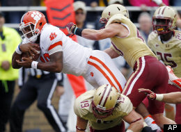 Clemson quarterback Tajh Boyd, top left, goes over Boston College defensive back Sean Sylvia to score in the first quarter of an NCAA college football game in Boston, Saturday, Sept. 29, 2012.