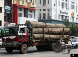 A truck loaded with teak logs runs on a road in Yangon, Myanmar, Thursday, Sept. 27, 2012.(AP Photo/Khin Maung Win)