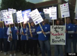 Teachers hit the picket lines in suburban Evergreen Park, Ill. Tuesday.
