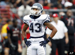 Connecticut running back Lyle McCombs stands on the field during the second half of an NCAA college football game against Rutgers in Piscataway, N.J., Saturday, Oct. 6, 2012. Rutgers won 19-3.