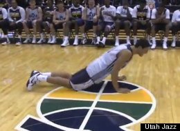 Utah Jazz center Enes Kanter attempts to do the worm during a rookie dance competition.