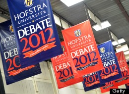 Signs are seen inside the media center as preparations continue October 14, 2012 for the second presidential debate at Mack Arena at Hofstra University in Hempstead, New York.(STAN HONDA/AFP/GettyImages)