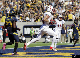 Stanford tight end Zach Ertz, center, runs in into the end zone past California defensive back Josh Hill (23) on a 20-yard touchdown catch during the first half of an NCAA college football game in Berkeley, Calif., Saturday, Oct. 20, 2012.