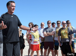 Republican presidential candidate Mitt Romney prepares to do a coin toss before the start of a touch football game on the beach with members of the Romney campaign staff versus some members of the traveling press corps on October 21, 2012 in Delray Beach, Florida. (Photo by Justin Sullivan/Getty Images)