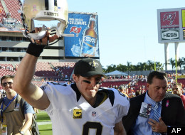 New Orleans Saints quarterback Drew Brees celebrates after the Saints defeated the Tampa Bay Buccaneers 35-28 during an NFL football game, Sunday, Oct. 21, 2012, in Tampa, Fla.