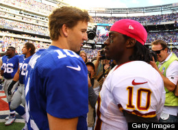 Eli Manning of the New York Giants meets Robert Griffin III of the Washington Redskins after the Giants 27-23 win at MetLife Stadium on October 21, 2012 in East Rutherford, New Jersey.