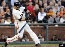 San Francisco Giants' Marco Scutaro hits a two-run double during the second inning of Game 6 of baseball's National League championship series against the St. Louis Cardinals Sunday, Oct. 21, 2012, in San Francisco.
