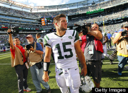 Tim Tebow of the New York Jets walks off the field after the Jets defeated the Buffalo Bills 48-28 during an NFL game at MetLife Stadium on September 9, 2012 in East Rutherford, New Jersey.