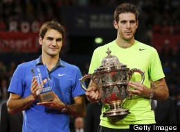 Argentina's Juan Martin Del Potro (R) poses with the trophy next to Switzerland's Roger Federer after winning his final match at the Swiss Indoors ATP tennis tournament on October 28, 2012 in Basel.