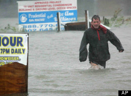 Bob Casseday crosses the waist high flooded street just over the bridge along Savannah Road in Lewes, Del., to get back home as Hurricane Sandy hits Delaware, Monday, Oct. 29, 2012.