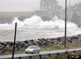 Centre: Waves hit the shore in Cow Bay, N.S. near Halifax on Tuesday, Oct. 30, 2012. The Atlantic region was mainly spared from the wrath of hurricane Sandy, but high winds and rain are expected to continue for the next day. Clockwise from left: Rescue at sea, tree down in Toronto, winds in Baltimore, flooding in New York (CP, AP photos)