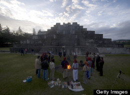 Indigenous priests take part in a Mayan ceremony at the Zaculeu archaeological site about 167 miles west of Guatemala City on July 21, 2012, before the end of