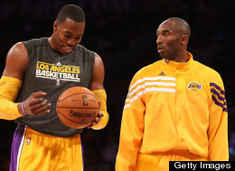 Dwight Howard and Kobe Bryant of the Los Angeles Lakers talks as they warm up to play the Sacramento Kings at Staples Center on October 21, 2012 in Los Angeles, California.
