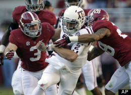 Texas A&M quarterback Johnny Manziel (2) is stopped after a first down run by Alabama defensive back Dee Milliner (28) and defensive back Vinnie Sunseri during the first half of an NCAA college football game at Bryant-Denny Stadium in Tuscaloosa, Ala., Saturday, Nov. 10, 2012.