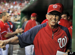 In this Sept. 1, 2012,, file photo, Washington Nationals manager Davey Johnson smiles in the dugout during a baseball game against the St. Louis Cardinals at Nationals Park in Washington.