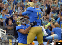 UCLA quarterback Brett Hundley, right, jumps into the arms of tight end Joseph Fauria after Fauria scored a touchdown during the first half of their NCAA college football game against USC, Saturday, Nov. 17, 2012, in Pasadena, Calif.