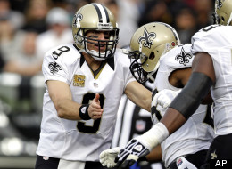 New Orleans Saints quarterback Drew Brees greets running back Mark Ingram after he scored a touchdown on a 27-yard run during the third quarter of an NFL football game against the Oakland Raiders in Oakland, Calif., Sunday, Nov. 18, 2012.