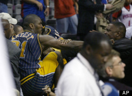 This Nov. 19, 2004 file photo shows Indiana Pacers forward Ron Artest fighting with a fan during a a brawl at a game against the Detroit Pistons, in Auburn Hills, Mich.