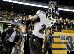 In this Sunday, Nov. 18, 2012, photo, Baltimore Ravens free safety Ed Reed runs onto the field prior to an NFL football game against the Pittsburgh Steelers in Pittsburgh.